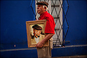 A man holds a picture of Chilean Nobel Prize Pablo Neruda.<br /> After 36 years, Chile's most popular folk singer, Victor Jara was mourned and buried. About 10.000 people attended to his vigil and funeral. Victor Jara was assassinated on September 15 1973 by Pinochet`s military officials of at least 43 gunshots and massive beatings. His 1973 funeral had to be made in private because of military restrictions.