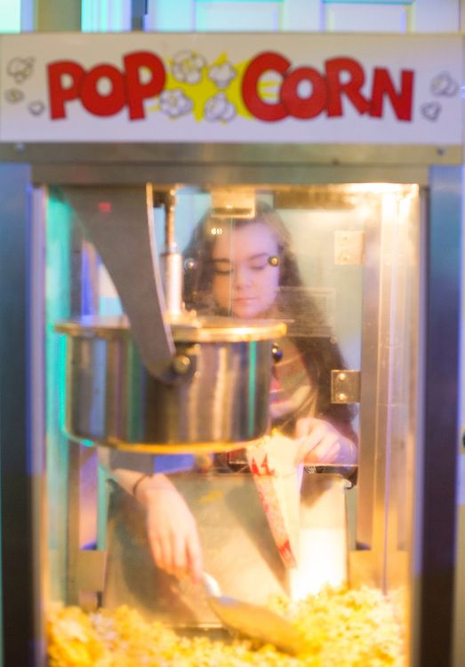 Freshman Caitlyn Lust scoops popcorn at the Sibs Carnival on February 6, 2016. Photo by Emily Matthews