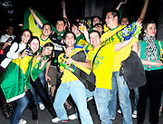 20.JUNE.2010. LONDON<br /> <br /> BRAZIL FANS IN LONDON CELEBRATE BRAZIL'S 3-1 WIN OVER IVORY COAST IN THE WORLD CUP.<br /> <br /> BYLINE: EDBIMAGEARCHIVE.COM<br /> <br /> *THIS IMAGE IS STRICTLY FOR UK NEWSPAPERS AND MAGAZINES ONLY FOR*<br /> *WORLD WIDE SALES AND WEB USE PLEASE CONTACT EDBIMAGEARCHIVE - 0208 954 5968*