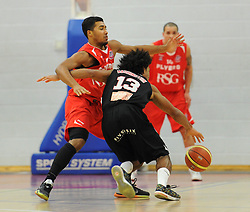 Bristol Flyers' Dwayne Lautier-Ogunleye challenges for the ball with Leicester Riders Connor Washington - Photo mandatory by-line: Dougie Allward/JMP - Mobile: 07966 386802 - 13/03/2015 - SPORT - Basketball - Bristol - SGS Wise Campus - Bristol Flyers v Leicester Riders - British Basketball League
