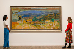"""© Licensed to London News Pictures. 21/01/2019. LONDON, UK. Staff members view """"Landscape at Le Cannet"""", 1928, by Pierre Bonnard.  Preview of an exhibition called """"Pierre Bonnard: The Colour of Memory"""" at Tate Modern.  This is the UK's first major Pierre Bonnard exhibition in 20 years bringing together around 100 of his works from around the world covering a period from 1912 to his death in 1947.  The works are on show 23 January to 6 May 2019.  Photo credit: Stephen Chung/LNP"""