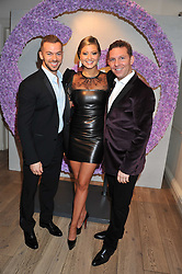 Left to right, ARTEM CHIGVINTSEV, HOLLLY VALANCE and NICK CANDY at a reception to celebrate the publication of Candy and Candy: The Art of Design held at the Halcyon Gallery, 24 Bruton Street, London W1 on 26th October 2011.