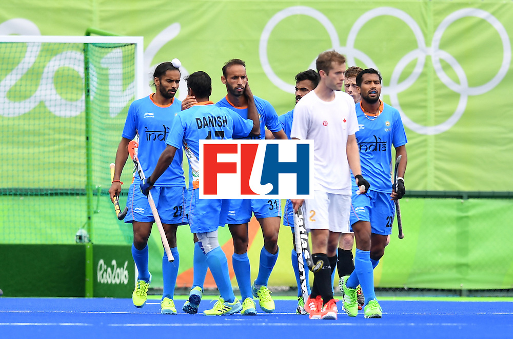 India's Ramandeep Singh (C) celebrates scoring with his teammates during the mens's field hockey India vs Canada match of the Rio 2016 Olympics Games at the Olympic Hockey Centre in Rio de Janeiro on August, 12 2016. / AFP / MANAN VATSYAYANA        (Photo credit should read MANAN VATSYAYANA/AFP/Getty Images)