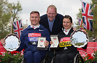 David Weir GBR and Manuela Schar SUI pose with Rob Diver with their winning salvers in the Elite Wheelchair Races. The Virgin Money London Marathon, 23rd April 2017.<br /> <br /> Photo: Jed Leicester for Virgin Money London Marathon<br /> <br /> For further information: media@londonmarathonevents.co.uk