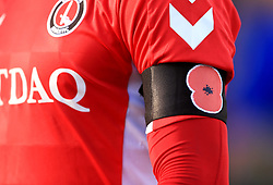 Close up of Charlton Athletic home shirt with a poppy appeal arm band