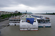 Vienna, Austria. The Danube reaches its highest level since the heavy flooding in 2002.<br /> Shipping is suspended, so a larger number of river cruise vessels is trapped at Vienna.