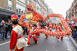 © Licensed to London News Pictures. 29/01/2017. London, UK.   Dragon dancers entertain the crowds, as the Chinese New Year parade takes place around Chinatown to celebrate the Year of the Rooster. Photo credit : Stephen Chung/LNP
