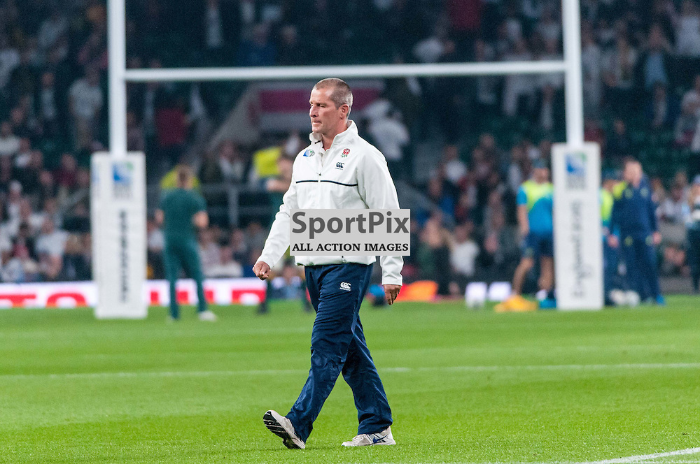 England coach Stuart Lancaster strides across the Twickenham pitch. Action from the England v Australia game in Pool A of the 2015 Rugby World Cup at Twickenham in London, 3 October 2015. (c) Paul J Roberts / Sportpix.org.uk