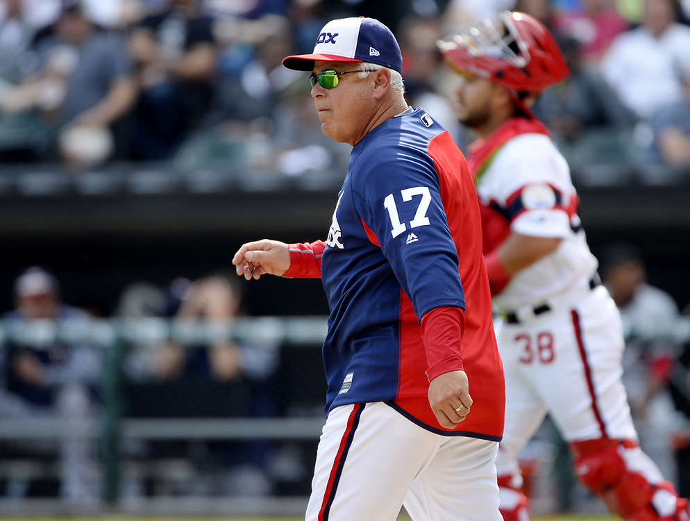 CHICAGO - APRIL 09:  Manager Rick Renteria #17 of the Chicago White Sox makes a pitching change during the game against the Minnesota Twins on April 9, 2017 at Guaranteed Rate Field in Chicago, Illinois.  (Photo by Ron Vesely)   Subject:  Rick Renteria