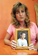 Penny Walters holds a picture of her son Matt Jones who died on July 30, 2004.  Photo by Elliot Knight