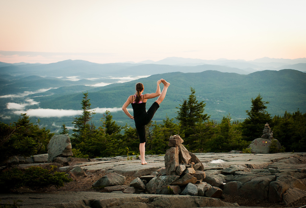 A Yogi practices balance as the Sun Comes up on Mount Kearsarge in NH.