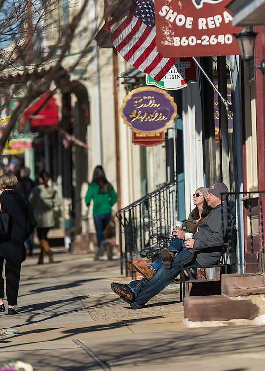 Bonnie Curran, of Newtown, and Steve McDonough, of Calgary, Canada, enjoy a sunny afternoon of people watching on State Street in Newtown, Pa, Monday, December 29, 2014. Photo by Bryan Woolston / @woolstonphoto.