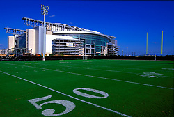 Stock photo of  an exterior view of Reliant Stadium from the fifty yard line of the adjacent practice field