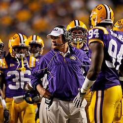 November 13, 2010; Baton Rouge, LA, USA; LSU Tigers head coach Les Miles talks to his defense during the first half of a game against the Louisiana Monroe Warhawks at Tiger Stadium.  Mandatory Credit: Derick E. Hingle