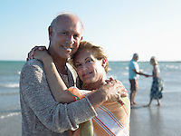 Senior couple embracing on beach