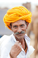 Portrait of a mature Indian camel herder at Pushkar Fair, Rajasthan, India.