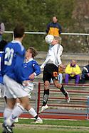 10.05.2003, Pori, Finland..Suomen Cup 4. kierros / Finnish Cup 4th round.FC Jazz Pori v FC Jokerit Helsinki.Jokereiden Tero Karhu puskee palloa naamallaan.©Juha Tamminen