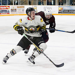 "TRENTON, ON  - MAY 3,  2017: Canadian Junior Hockey League, Central Canadian Jr. ""A"" Championship. The Dudley Hewitt Cup. Game 3 between Powassan Voodoos and the Dryden GM Ice Dogs.  Ryan Theriault #15 of the Powassan Voodoos is pursued by Tristan Knott #9 of the Dryden GM Ice Dogs during the third period.<br /> (Photo by Tim Bates / OJHL Images)"