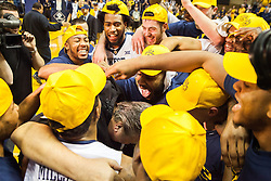 Dec 17, 2016; Morgantown, WV, USA; West Virginia Mountaineers head coach Bob Huggins and players celebrate Huggins reaching 800 career wins at WVU Coliseum. Mandatory Credit: Ben Queen-USA TODAY Sports