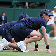 LONDON, ENGLAND - JULY 14: Ball boy's in action on Center Court during the Wimbledon Lawn Tennis Championships at the All England Lawn Tennis and Croquet Club at Wimbledon on July 14, 2017 in London, England. (Photo by Tim Clayton/Corbis via Getty Images)