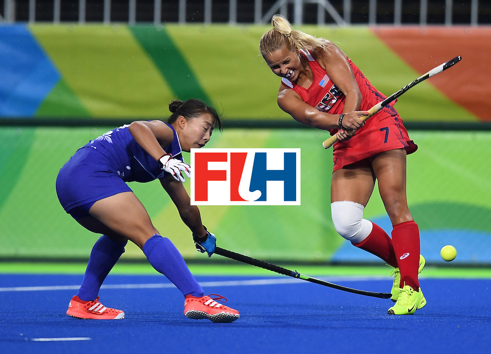 The USA's Kelsey Kolojejchick hits the ball during the women's field hockey USA vs Japan match of the Rio 2016 Olympics Games at the Olympic Hockey Centre in Rio de Janeiro on August, 10 2016. / AFP / MANAN VATSYAYANA        (Photo credit should read MANAN VATSYAYANA/AFP/Getty Images)