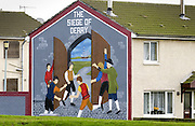 Protest mural depicts The Siege of Derry painted on house wall in Belfast, Northern Ireland