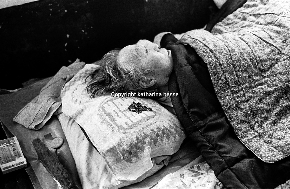 ANGUO, 1 APRIL, 2001: an old nun lies in her bed in a home for retired catholics.China cut relations with the Vatican in the early fifites and since then, established a Patriotic catholic Church that's controlled by Chinese authorities.<br />Catholics who refused to give up their ties with the Vatican, started worshipping in underground churches and consequently were persecuted for a long time. Since the late nineties though, relations with the Vatican informally started to improve. Although China still has no diplomatic relations, many representatives from official churches met the pope John Paull II secretely . The Vatican, under the pope's leadership, has made several efforts to recover the tie with China. In February 2006 , Hong Kong Bishop Joseph Zen was named one of the first 15 new cardinals, which is seen by many as a gesture of goodwill and a significant step towards recovering the Vatican-China relationship.