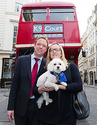 © Licensed to London News Pictures. File picture dated  20/02/17. Gabby (Gabrielle) and Florian Kuehn with Vinnie the dog, in front of a supporters bus as they arrived outside the Mayor's and City of London court in London on 20th February 2017. An appeal hearing at the High Court has been brought by the Kuehn's against the blanket no pet policy clause in the leasehold agreement issued by their property management company, Victory Place. The appeal follows a previous hearing at the Mayor's and City of London magistrates court held in February 2017 when Victory Place Management Company brought and won an action to evict the couples dog, Vinnie, a Maltese-Yorkshire terrier cross. The Kuehn's have appealed against the original judgement and are challenging the legality of blanket no pet policies in leasehold contracts. Victory Place Management Company have lodged a counter appeal. Photo credit: Vickie Flores/LNP