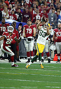 Green Bay Packers wide receiver Jeff Janis (83) is covered by Arizona Cardinals cornerback Justin Bethel (28) as he catches a 60 yard Hail Mary pass for a first down at the Arizona Cardinals 36 yard line on fourth down with 20 yards to go and under one minute left in the fourth quarter during the NFL NFC Divisional round playoff football game against the Arizona Cardinals on Saturday, Jan. 16, 2016 in Glendale, Ariz. The Cardinals won the game in overtime 26-20. (©Paul Anthony Spinelli)
