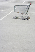 empty shopping cart parked in a car parking spot