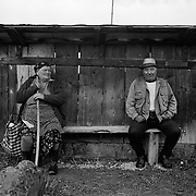 ROMANIA- MAY 09: A elderly lady and gentleman wait in a shelter during rain in the rural region of Maramures, Romania. Photo Tim Clayton..Romania entered the European Economic Community in January 2007, signaling a fresh exodus of the work force as many Romanians fled the country in search of a better life. Sadly many have not found the employment sought and Romanian communities camped in European cities are making headlines for all the wrong reasons...In a nation recovering from communist rule from 1947 to 1989 and a decade of economic instability and decline that followed, it is estimated Romania has lost between 2.0 and 2.5 million of it's workforce since the end of communist rule. Considering Romanian's population is estimated at 22 million, this is about 10% of the Country's population...Life goes on as normal for those who have remained in Romania. In a country steeped in history and culture there has been little or no change in age old traditions, life is personified in the rural communities where a third of Romanian's population is employed in agriculture and primary production, one of the highest in Europe.