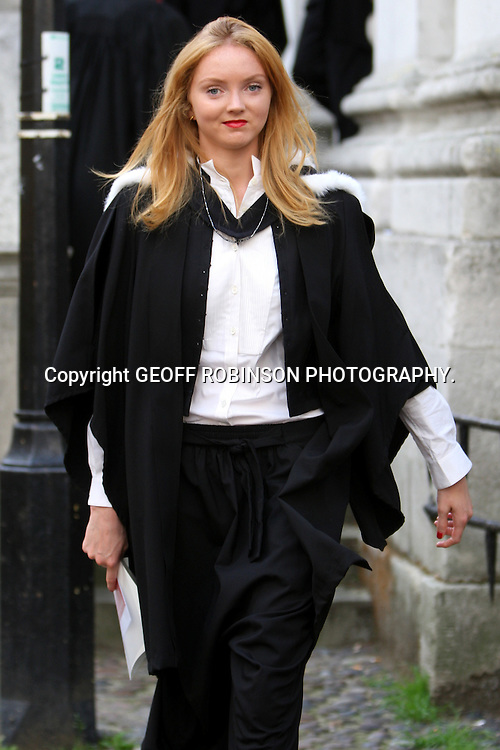 LILY COLE IN CAMBRIDGE     AFTER COLLECTING HER DEGREE AT THE SENATE HOUSE... Supermodel Lily Cole returned to Cambridge University today (Thurs) for her graduation ceremony - a week after scoring a double first class degree...Lily paraded from King's College to the historic Senate House to receive her degree certificate as her proud mum and family watched and took photos...She wore her black graduation gown as she walked in procession with around 100 students from the college, where she has studied for the last three years...She looked happy and relaxed as she left the ceremony clutching her certificate and joined her family and friends on the college lawns...After the ceremony Lily, who wore a white top and black skirt, and the other new graduates were joined by Fellows, college staff, friends and family for a buffet lunch party in the Provost's Garden...The skinny model has proved she has brains as well as beauty after gaining the highest possible award in History of Art...SEE COPY CATCHLINE Lily Cole graduates from Cam Uni