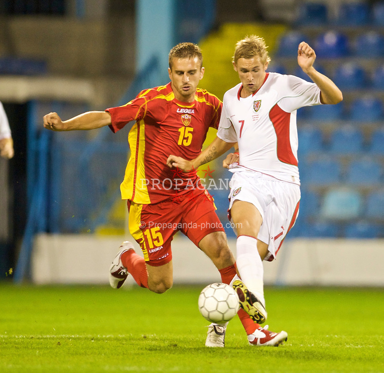 PODGORICA, MONTENEGRO - Wednesday, August 12, 2009: Wales' Jack Collison and Montenegro's Simon Vukcevic during an international friendly match at the Gradski Stadion. (Photo by David Rawcliffe/Propaganda)