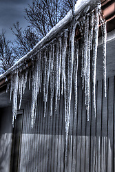 09 February 2014:   Icicles hang from a gutter as a gentle thaw begins.  The thaw will be short lived as more cold weather is forecast for the 3rd coldest winter in history of Central Illinois<br /> <br /> This image has been altered using HDR (High Dynamic Range) processes.