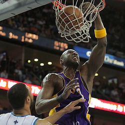 23 December 2008: Los Angeles Lakers forward Lamar Odom (7) dunks over New Orleans Hornets center Tyson Chandler (6) during a 100-87 loss by the New Orleans Hornets to the Los Angeles Lakers at the New Orleans Arena in New Orleans, LA. .