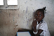 Kinshasa, DRC. March 2009. EP1 School in Ikisi District. UNICEF donate text books that are shared amongst the older grades.  .UNICEF is also providing copy books, writing boards and desks to help improve conditions in the classroom.  According to national averages, only 24 per cent  of children graduate with enrolment rates only at 51 per cent for boys and 27 per cent for girls.