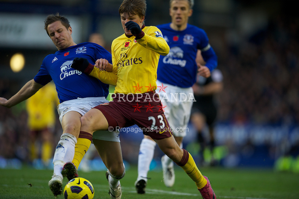 LIVERPOOL, ENGLAND - Sunday, November 14, 2010: Everton's Phil Jagielka and Arsenal's Andrey Arshavin during the Premiership match at Goodison Park. (Photo by: David Rawcliffe/Propaganda)