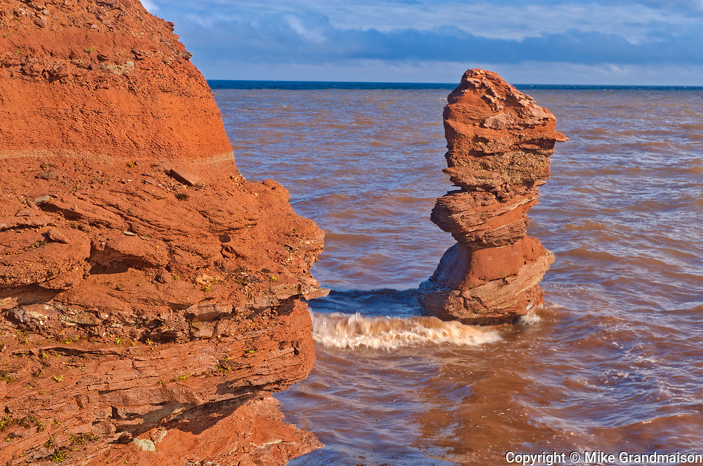Red sandstone cliffs along the Gulf of St. Lawrence. SIte of the remnant of 'Elephant Rock'.<br />North Cape<br />Prince Edward Island<br />Canada