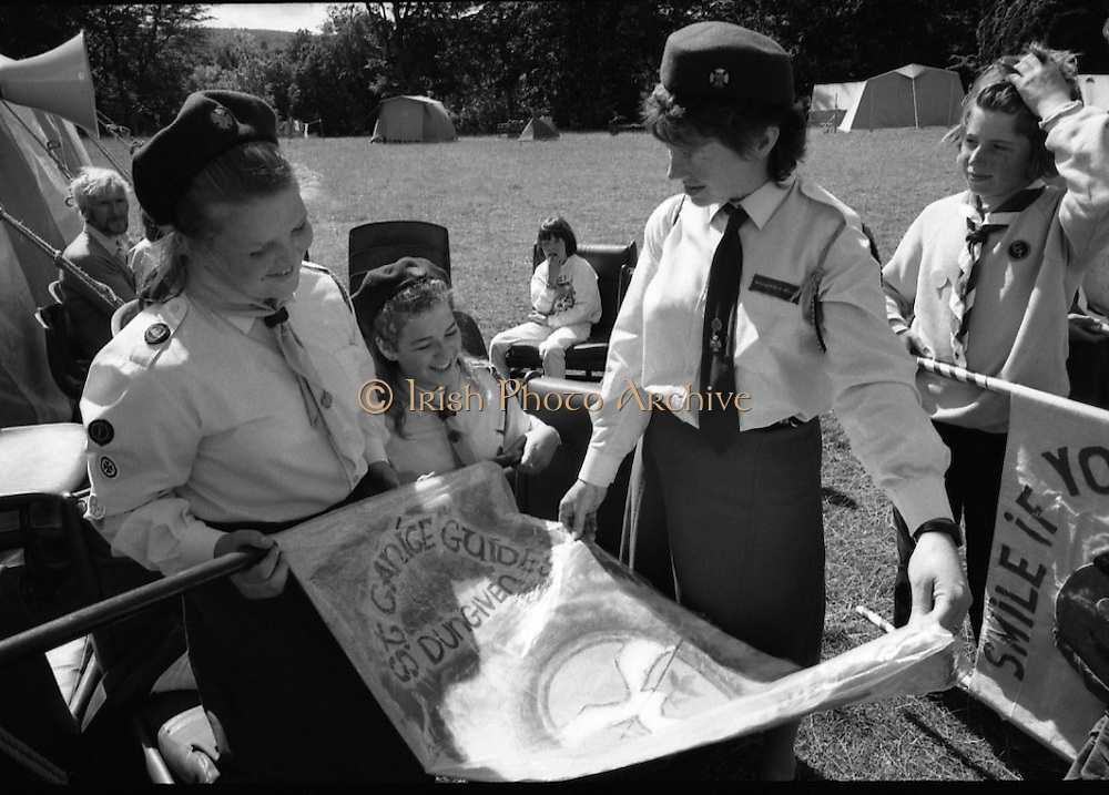 300 Girl Guides At Larch Hill.  (R84)..1988..25.07.1988..07.25.1988..25th July 1988..As part of the Diamond Jubilee celebrations the girl guide movement organised a friendship camp for 300 girls.The friendship camp was set up in the grounds of Larch Hill, Tibradden,Co Dublin. The camp will run from 23rd July to 30th July...Guides from all over the country took part in the event. This image shows a guide group from St Canice's guides, Dungiven, Co Derry.