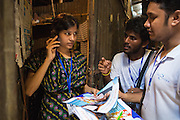 Roxana, a garment worker in Dhaka, Bangladesh, talking to the community fieldstaff from LaborVoices.<br /> <br /> She is taking part in a survey called SmartLine, which allows garment workers to share feedback on their safety and working conditions, quickly and anonymously via their mobile phone.<br /> <br /> The SmartLine provides brands and suppliers real-time visibility into factory conditions, enabling them to identify and solve problems before they become urgent.
