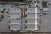 "Locked doors on the top deck on-board the Royal Navy's aircraft carrier HMS Illustrious. Illustrious is the second of three Invincible-class light aircraft carriers built for the Royal Navy in the late 1970s and early 1980s. She is the fifth warship and second aircraft carrier to bear the name Illustrious, and is affectionately known to her crew as ""Lusty"". She is the oldest ship in the Royal Navy's active fleet , expected  to be  withdrawn from service in 2014 (after 32 years' service)."