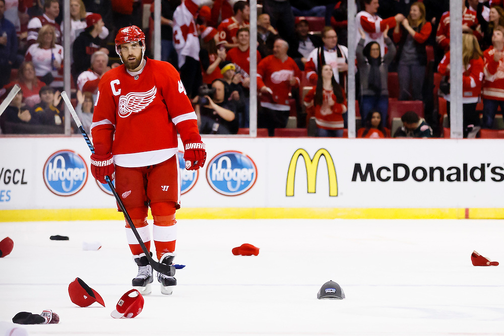 Jan 18, 2015; Detroit, MI, USA; Hats rain down on the ice after Detroit Red Wings left wing Henrik Zetterberg (40) scores his third goal against the Buffalo Sabres in the third period at Joe Louis Arena. Detroit won 6-4. Mandatory Credit: Rick Osentoski-USA TODAY Sports