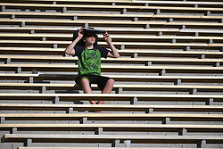 Sep 1, 2018; Columbia, MO, USA; A fan uses his seat back to shield from the sun during the second half of the game between the Missouri Tigers and the Tennessee Martin Skyhawks at Memorial Stadium/Faurot Field. Mandatory Credit: Denny Medley-USA TODAY Sports