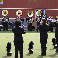 Amory High School's marching band prepares for the competition in one of the many warm-up areas at Tupelo High School
