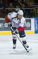 KELOWNA, CANADA - NOVEMBER 28:  Justin Feser #22 of the Tri City Americans skates on the ice with the puck at the Kelowna Rockets on November 28, 2012 at Prospera Place in Kelowna, British Columbia, Canada (Photo by Marissa Baecker/Shoot the Breeze) *** Local Caption ***