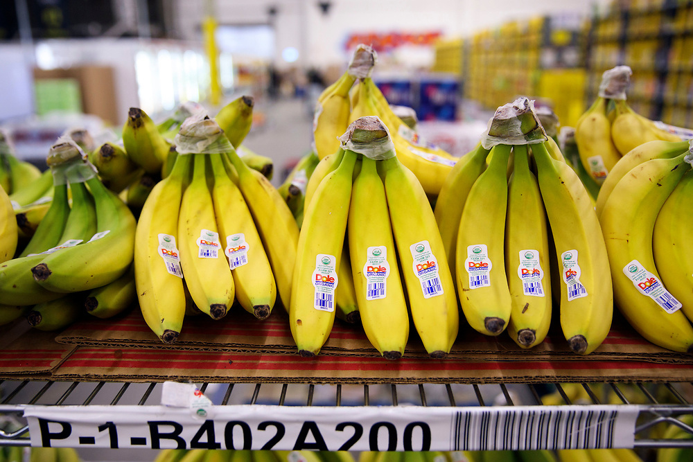 Fresh bananas rest on shelves at the Amazon.com Inc. Prime Now fulfillment center warehouse on Monday, March 27, 2017 in Los Angeles, Calif. The warehouse can fulfill one and two hour delivery to customers. Complex supply chains such as Amazon's and e-commerce trends will impact city infrastructure and how things move through cities. © 2017 Patrick T. Fallon