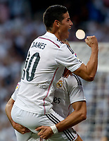 """Spanish  League""- match Real Madrid Vs FC Barcelona- season 2014-15 - Santiago Bernabeu Stadium - James Rodriguez and Karim Benzema (Real Madrid) Celebrates a goal during the Spanish League match against FC Barcelona(Photo: Guillermo Martinez / Bohza Press / Alter Photos)"