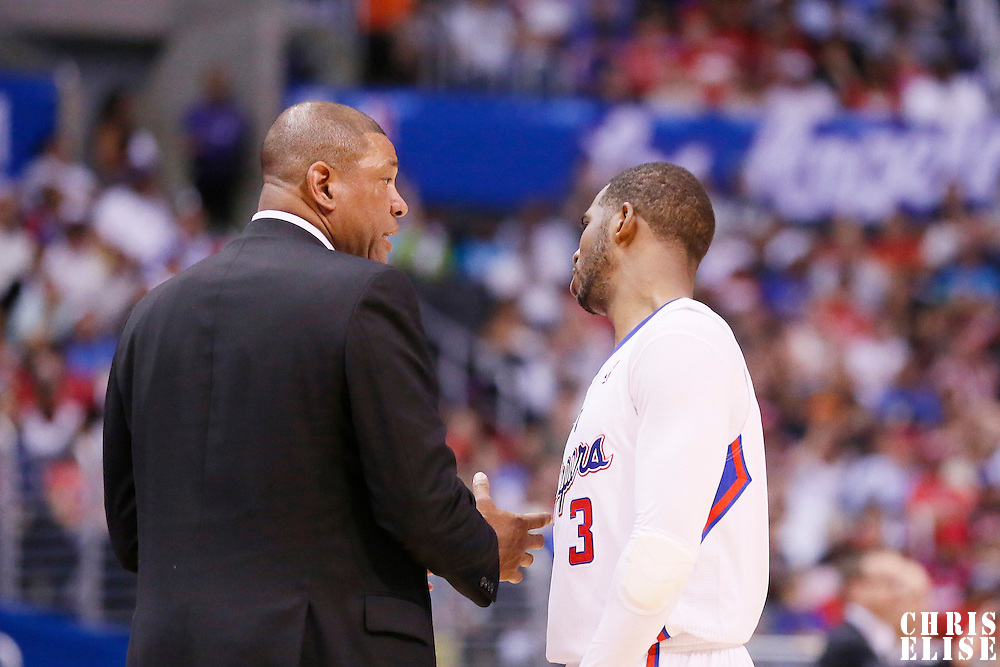 11 May 2014: Los Angeles Clippers head coach Doc Rivers talks to Los Angeles Clippers guard Chris Paul (3) during the Los Angeles Clippers 101-99 victory over the Oklahoma City Thunder, during Game Four of the Western Conference Semifinals of the NBA Playoffs, at the Staples Center, Los Angeles, California, USA.