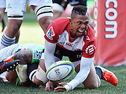 Lions v Highlanders. Elton Jantjies of the Emirates Lions celebrates his try with Ash Dixon of the Highlanders too late to stop him during the 2016 Super Rugby semi-final match at Ellis Park, Johannesburg, 30 July 2016. <br /> <br /> © Anton de Villiers / www.photosport.nz