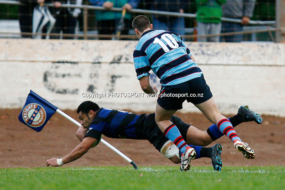 Ponsonby Roger Tuamoheloa dives for a try infront of Marist Mitch McGahan during the Waka Nathan Challenge Cup Final, Auckland Premier Club Rugby match, Ponsonby v Marist at Western Springs Stadium, Auckland, New Zealand. Saturday 6 June 2009. Photo: Anthony Au-Yeung/PHOTOSPORT